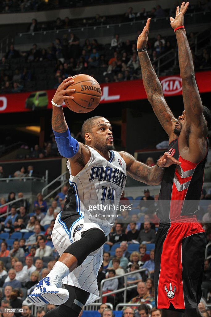<a gi-track='captionPersonalityLinkClicked' href=/galleries/search?phrase=Jameer+Nelson&family=editorial&specificpeople=202057 ng-click='$event.stopPropagation()'>Jameer Nelson</a> #14 of the Orlando Magic drives to the basket during a game against the Toronto Raptrs on January 24, 2013 at Amway Center in Orlando, Florida.