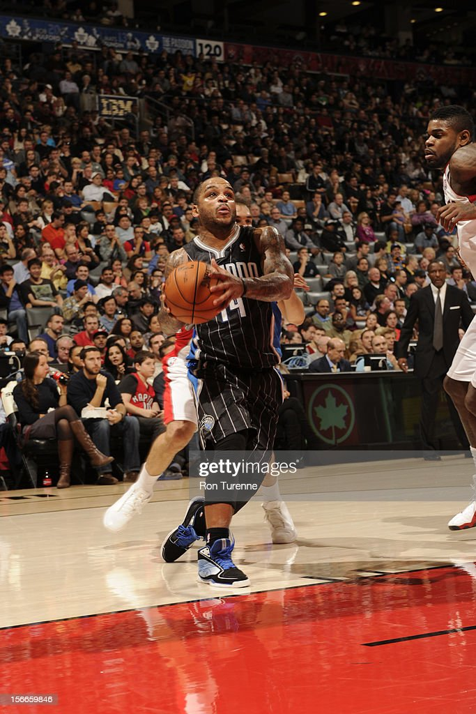 Jameer Nelson #14 of the Orlando Magic drives to the hoop vs the Toronto Raptors during the game on November 18, 2012 at the Air Canada Centre in Toronto, Ontario, Canada.
