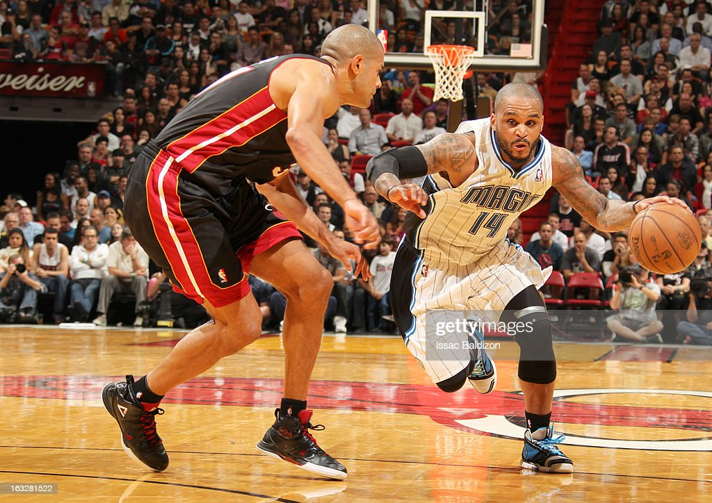 Jameer Nelson #14 of the Orlando Magic drives under pressure during the game between the Orlando Magic and the Miami Heat on March 6, 2013 at American Airlines Arena in Miami, Florida.