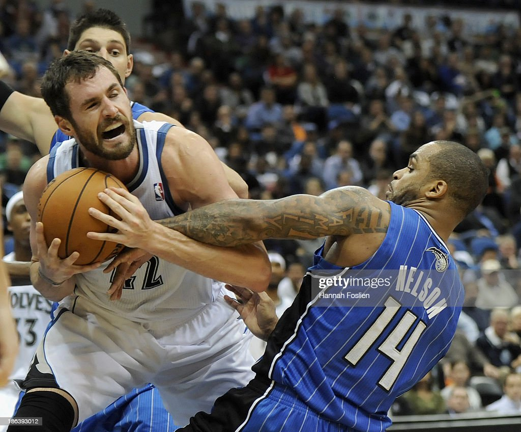 Jameer Nelson #14 of the Orlando Magic fouls Kevin Love #42 of the Minnesota Timberwolves during the fourth quarter of the season opening game on October 30, 2013 at Target Center in Minneapolis, Minnesota. The Timberwolves defeated the Magic 120-115 in overtime.