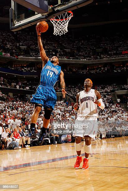 Jameer Nelson of the Orlando Magic goes for the layup against Stephen Jackson of the Charlotte Bobcats in Game Three of the Eastern Conference...