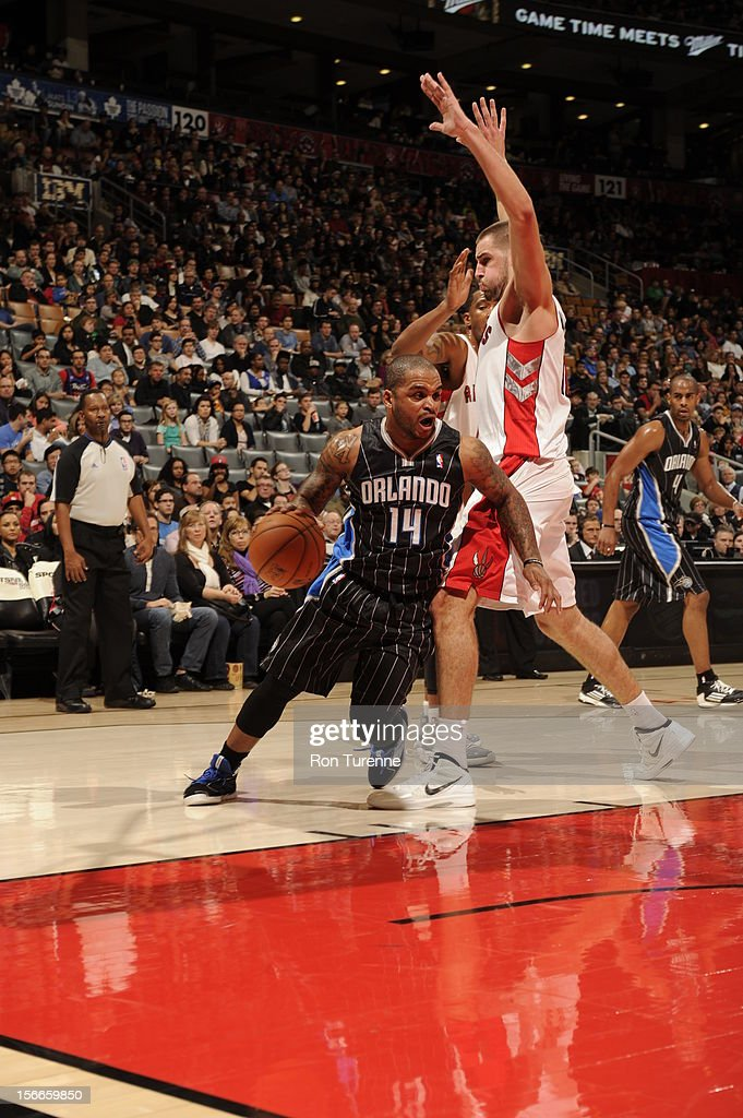 <a gi-track='captionPersonalityLinkClicked' href=/galleries/search?phrase=Jameer+Nelson&family=editorial&specificpeople=202057 ng-click='$event.stopPropagation()'>Jameer Nelson</a> #14 of the Orlando Magic goes to the basket vs the Toronto Raptors during the game on November 18, 2012 at the Air Canada Centre in Toronto, Ontario, Canada.