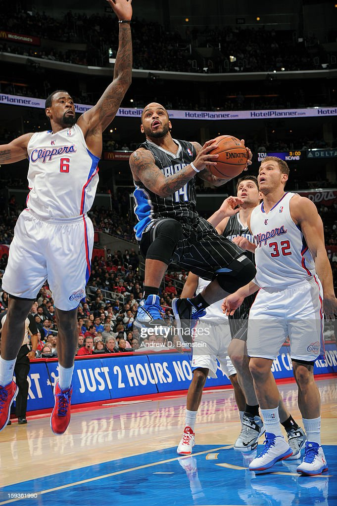 <a gi-track='captionPersonalityLinkClicked' href=/galleries/search?phrase=Jameer+Nelson&family=editorial&specificpeople=202057 ng-click='$event.stopPropagation()'>Jameer Nelson</a> #14 of the Orlando Magic goes up for the layup in traffic against the Los Angeles Clippers at Staples Center on January 12, 2013 in Los Angeles, California.