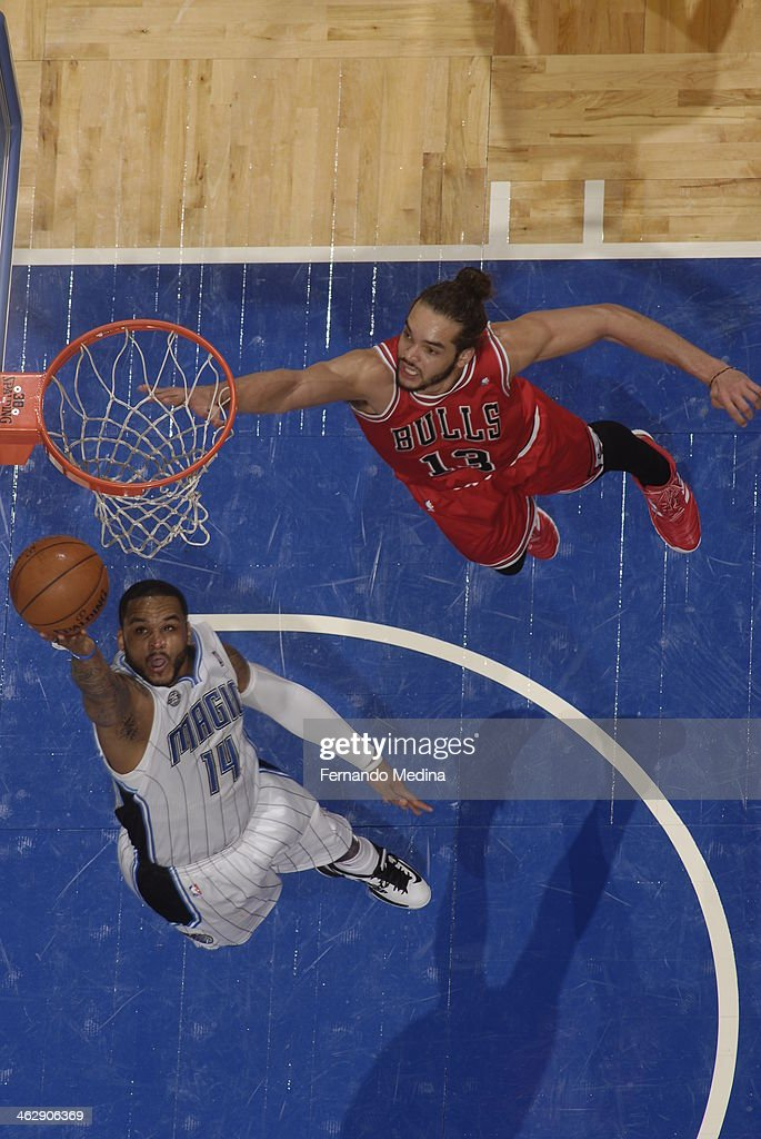 Jameer Nelson #14 of the Orlando Magic goes up for the reverse layup against the Chicago Bulls Bulls during the game on January 15, 2014 at Amway Center in Orlando, Florida.