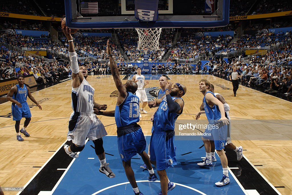 <a gi-track='captionPersonalityLinkClicked' href=/galleries/search?phrase=Jameer+Nelson&family=editorial&specificpeople=202057 ng-click='$event.stopPropagation()'>Jameer Nelson</a> #14 of the Orlando Magic goes up for the shot against the Dallas Mavericks during the game on January 20, 2013 at Amway Center in Orlando, Florida.