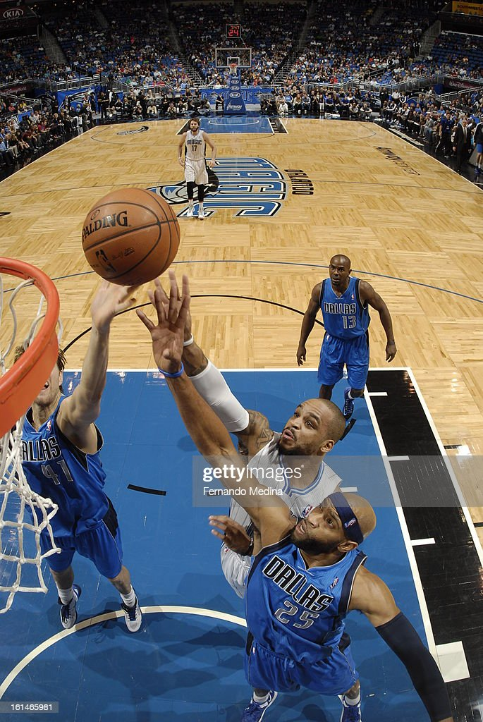 <a gi-track='captionPersonalityLinkClicked' href=/galleries/search?phrase=Jameer+Nelson&family=editorial&specificpeople=202057 ng-click='$event.stopPropagation()'>Jameer Nelson</a> #14 of the Orlando Magic goes up for the tip-in against the Dallas Mavericks during the game on January 20, 2013 at Amway Center in Orlando, Florida.