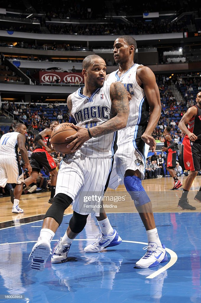 Jameer Nelson #14 of the Orlando Magic grabs the rebound against the Toronto Raptors during the game on January 24, 2013 at Amway Center in Orlando, Florida.