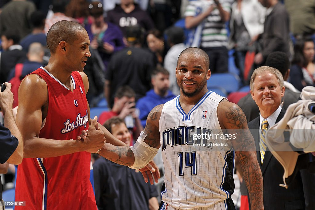 <a gi-track='captionPersonalityLinkClicked' href=/galleries/search?phrase=Jameer+Nelson&family=editorial&specificpeople=202057 ng-click='$event.stopPropagation()'>Jameer Nelson</a> #14 of the Orlando Magic greets <a gi-track='captionPersonalityLinkClicked' href=/galleries/search?phrase=Grant+Hill+-+Basketball+Player&family=editorial&specificpeople=201658 ng-click='$event.stopPropagation()'>Grant Hill</a> #33 of the Los Angeles Clippers on February 6, 2013 at Amway Center in Orlando, Florida.