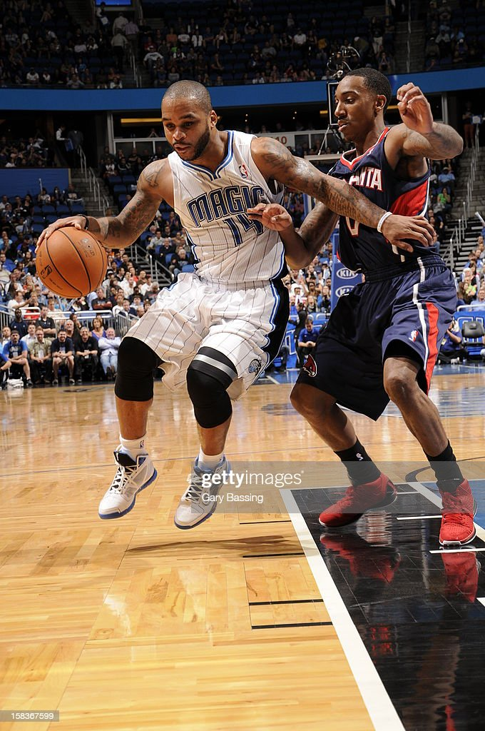 <a gi-track='captionPersonalityLinkClicked' href=/galleries/search?phrase=Jameer+Nelson&family=editorial&specificpeople=202057 ng-click='$event.stopPropagation()'>Jameer Nelson</a> #14 of the Orlando Magic handles the ball against <a gi-track='captionPersonalityLinkClicked' href=/galleries/search?phrase=Jeff+Teague&family=editorial&specificpeople=4680498 ng-click='$event.stopPropagation()'>Jeff Teague</a> #0 of the Atlanta Hawks on December 12, 2012 at Amway Center in Orlando, Florida.