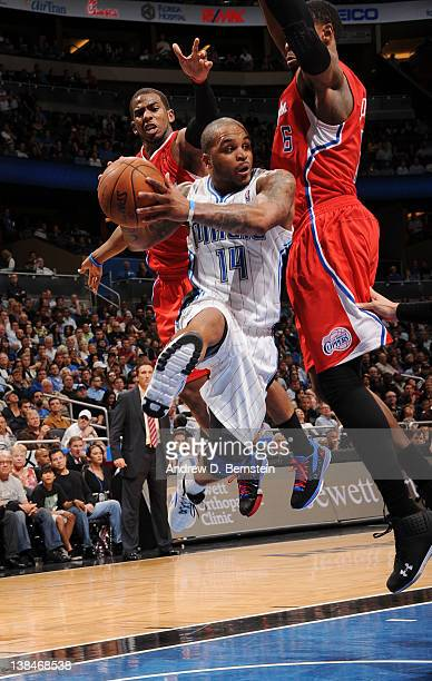 Jameer Nelson of the Orlando Magic leaps in the air as he attempts a pass against Chris Paul and DeAndre Jordan of the Los Angeles Clippers during...