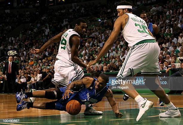 Jameer Nelson of the Orlando Magic loses the ball as he drives against Tony ALlen and Rasheed Wallace of the Boston Celtics in Game Four of the...