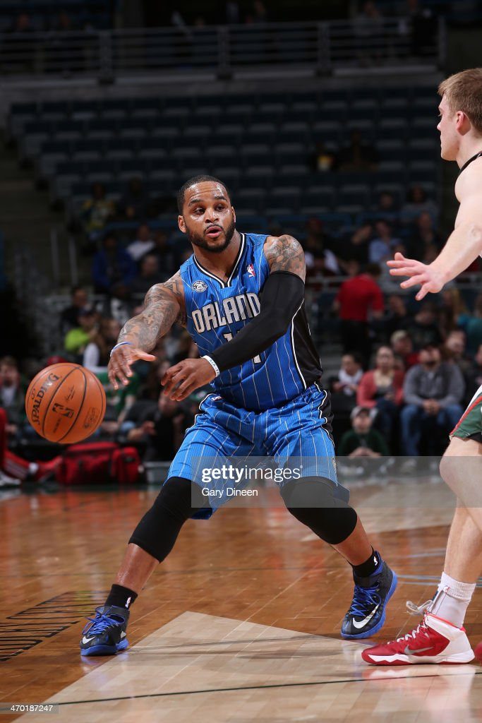 Jameer Nelson #14 of the Orlando Magic passes against the Milwaukee Bucks on February 18, 2014 at the BMO Harris Bradley Center in Milwaukee, Wisconsin.