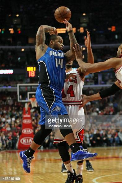 Jameer Nelson of the Orlando Magic passes over his head and behind his back over DJ Augustin of the Chicago Bulls at the United Center on December 16...