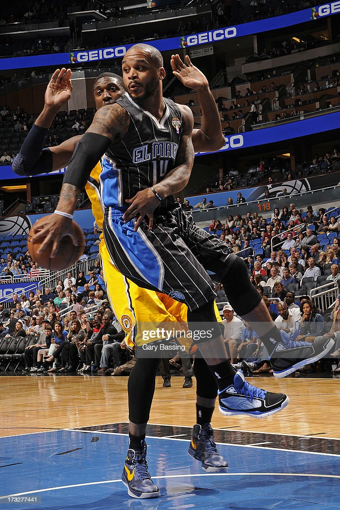 <a gi-track='captionPersonalityLinkClicked' href=/galleries/search?phrase=Jameer+Nelson&family=editorial&specificpeople=202057 ng-click='$event.stopPropagation()'>Jameer Nelson</a> #14 of the Orlando Magic passes the ball in midair while guarded by <a gi-track='captionPersonalityLinkClicked' href=/galleries/search?phrase=Roy+Hibbert&family=editorial&specificpeople=725128 ng-click='$event.stopPropagation()'>Roy Hibbert</a> #55 of the Indiana Pacers during a game on March 8, 2013 at Amway Center in Orlando, Florida.
