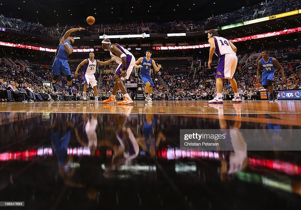 <a gi-track='captionPersonalityLinkClicked' href=/galleries/search?phrase=Jameer+Nelson&family=editorial&specificpeople=202057 ng-click='$event.stopPropagation()'>Jameer Nelson</a> #14 of the Orlando Magic passes the ball under pressure from <a gi-track='captionPersonalityLinkClicked' href=/galleries/search?phrase=Sebastian+Telfair&family=editorial&specificpeople=202087 ng-click='$event.stopPropagation()'>Sebastian Telfair</a> #31 of the Phoenix Suns during the NBA game at US Airways Center on December 9, 2012 in Phoenix, Arizona. The Magic defeated the Suns 98-90.