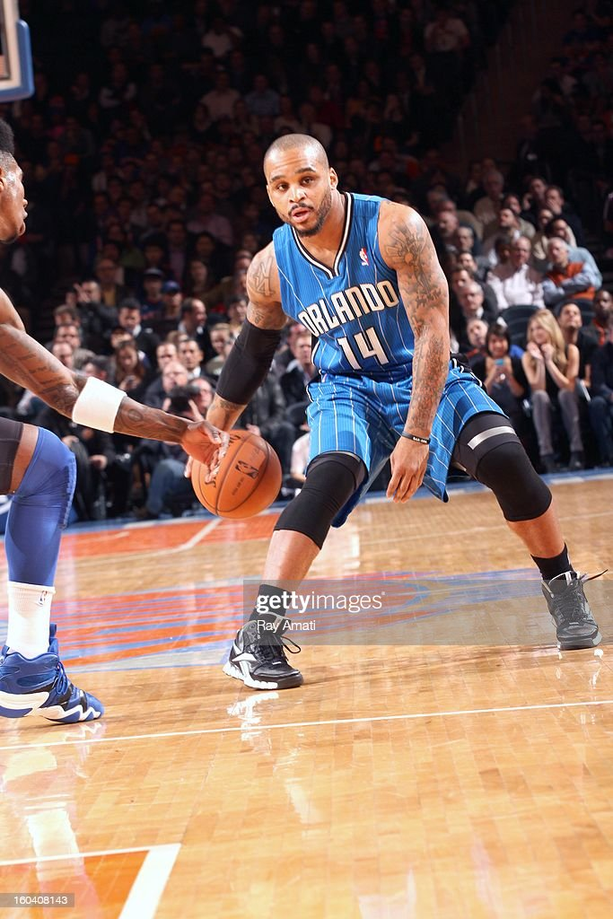 Jameer Nelson #14 of the Orlando Magic protects the ball during the game between the New York Knicks and the Orlando Magic on January 30, 2013 at Madison Square Garden in New York City .