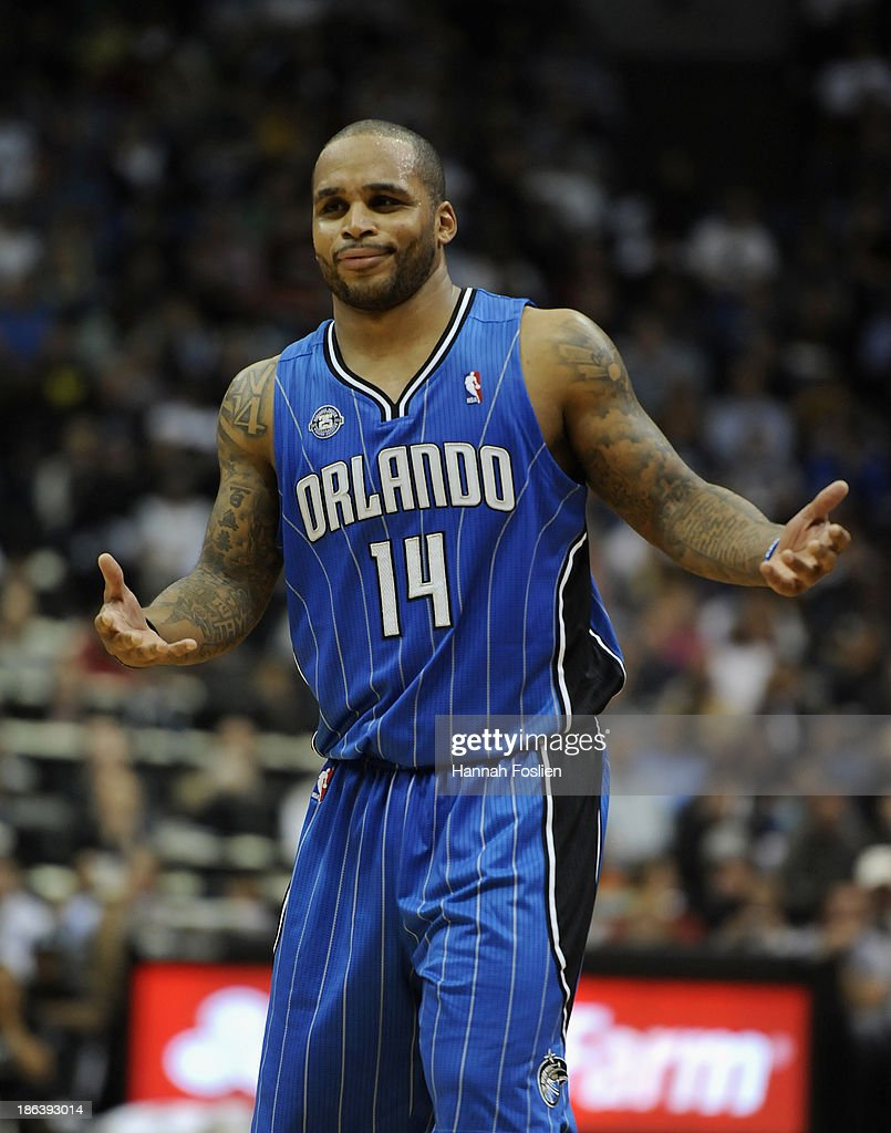 Jameer Nelson #14 of the Orlando Magic reacts during the third quarter of the season opening game against the Minnesota Timberwolves on October 30, 2013 at Target Center in Minneapolis, Minnesota. The Timberwolves defeated the Magic 120-115 in overtime.