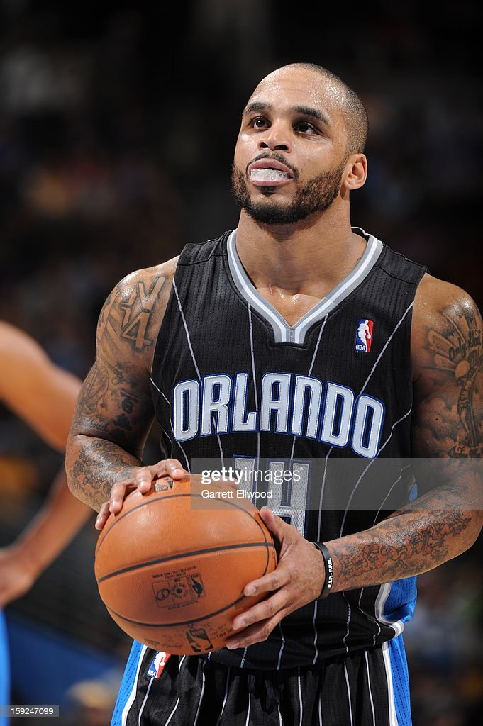 <a gi-track='captionPersonalityLinkClicked' href=/galleries/search?phrase=Jameer+Nelson&family=editorial&specificpeople=202057 ng-click='$event.stopPropagation()'>Jameer Nelson</a> #14 of the Orlando Magic shoots a free throw against the Denver Nuggets on January 9, 2013 at the Pepsi Center in Denver, Colorado.