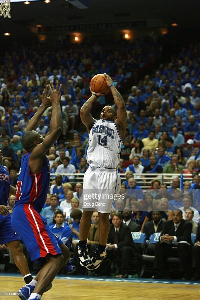 Jameer Nelson #14 of the Orlando Magic shoots a jump shot over Dale Davis #34 of the Detroit Pistons in Game Three of the Eastern Conference Quarterfinals during the 2007 NBA Playoffs at Amway Arena on April 26, 2007 in Orlando, Florida. The Pistons won 93-77.
