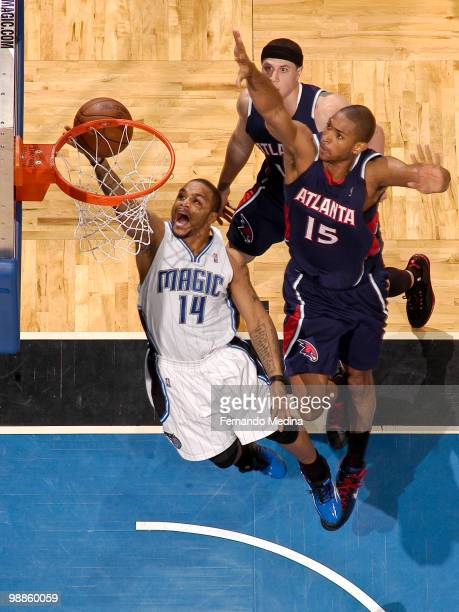 Jameer Nelson of the Orlando Magic shoots a layup against Al Horford of the Atlanta Hawks in Game One of the Eastern Conference Semifinals during the...