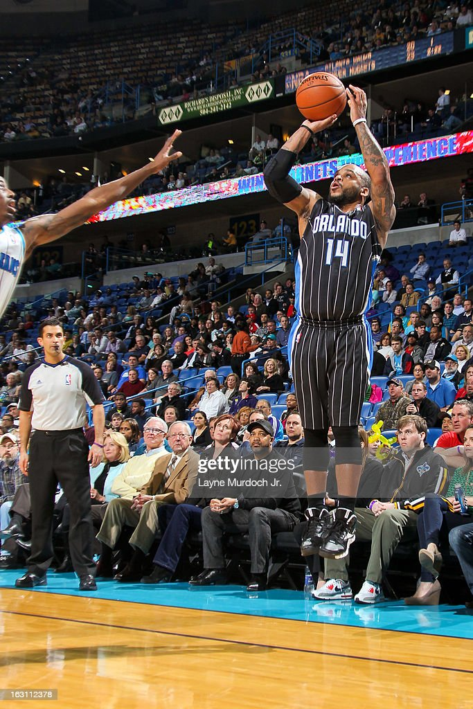 Jameer Nelson #14 of the Orlando Magic shoots a three-pointer against the New Orleans Hornets on March 4, 2013 at the New Orleans Arena in New Orleans, Louisiana.