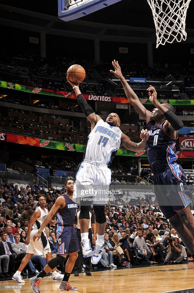 Jameer Nelson #14 of the Orlando Magic shoots against Bismack Biyombo #0 of the Charlotte Bobcats on January 18, 2013 at Amway Center in Orlando, Florida.
