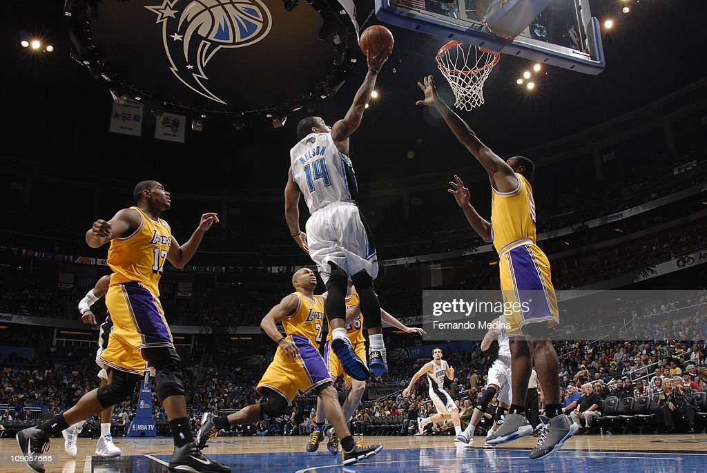 <a gi-track='captionPersonalityLinkClicked' href=/galleries/search?phrase=Jameer+Nelson&family=editorial&specificpeople=202057 ng-click='$event.stopPropagation()'>Jameer Nelson</a> #14 of the Orlando Magic shoots against <a gi-track='captionPersonalityLinkClicked' href=/galleries/search?phrase=Derek+Fisher&family=editorial&specificpeople=201724 ng-click='$event.stopPropagation()'>Derek Fisher</a> #2 of the Los Angeles Lakers on February 13, 2011 at the Amway Center in Orlando, Florida.