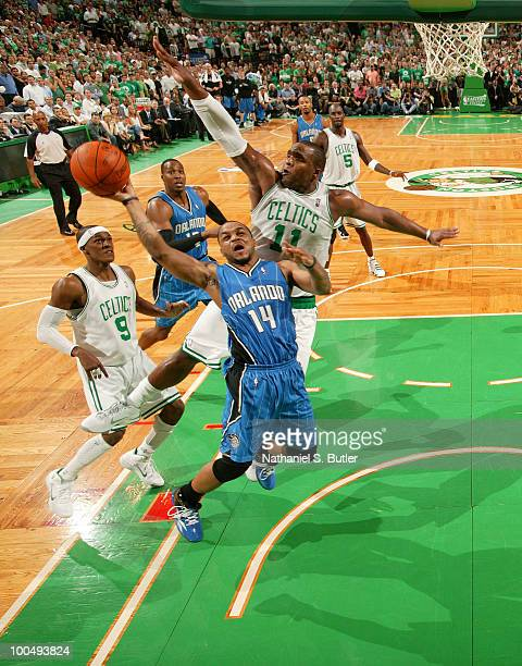 Jameer Nelson of the Orlando Magic shoots against Glen Davis of the Boston Celtics in Game Four of the Eastern Conference Finals during the 2010 NBA...