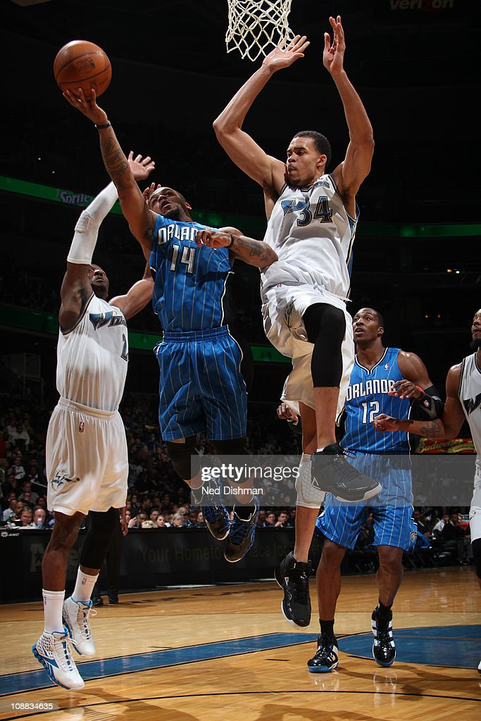 <a gi-track='captionPersonalityLinkClicked' href=/galleries/search?phrase=Jameer+Nelson&family=editorial&specificpeople=202057 ng-click='$event.stopPropagation()'>Jameer Nelson</a> #14 of the Orlando Magic shoots against <a gi-track='captionPersonalityLinkClicked' href=/galleries/search?phrase=John+Wall&family=editorial&specificpeople=2265812 ng-click='$event.stopPropagation()'>John Wall</a> #2 and <a gi-track='captionPersonalityLinkClicked' href=/galleries/search?phrase=JaVale+McGee&family=editorial&specificpeople=4195625 ng-click='$event.stopPropagation()'>JaVale McGee</a> #34 of the Washington Wizards on February 04, 2011 at the Verizon Center in Washington, DC.