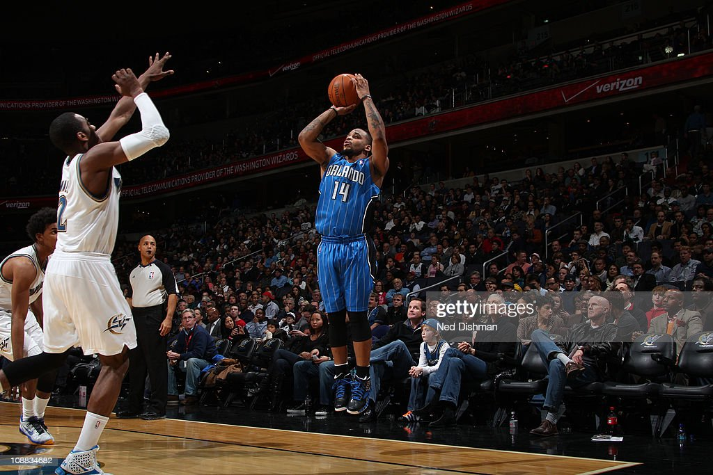 <a gi-track='captionPersonalityLinkClicked' href=/galleries/search?phrase=Jameer+Nelson&family=editorial&specificpeople=202057 ng-click='$event.stopPropagation()'>Jameer Nelson</a> #14 of the Orlando Magic shoots against <a gi-track='captionPersonalityLinkClicked' href=/galleries/search?phrase=John+Wall&family=editorial&specificpeople=2265812 ng-click='$event.stopPropagation()'>John Wall</a> #2 of the Washington Wizards on February 04, 2011 at the Verizon Center in Washington, DC.