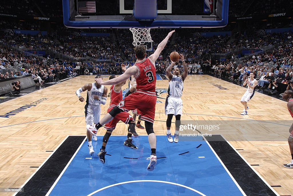 <a gi-track='captionPersonalityLinkClicked' href=/galleries/search?phrase=Jameer+Nelson&family=editorial&specificpeople=202057 ng-click='$event.stopPropagation()'>Jameer Nelson</a> #14 of the Orlando Magic shoots against Omer Asik #3 of the Chicago Bulls on March 4, 2011 at the Amway Center in Orlando, Florida.