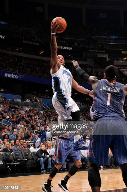 Jameer Nelson of the Orlando Magic shoots against Stephen Jackson of the Charlotte Bobcats during the game on February 27 2011 at the Amway Center in...