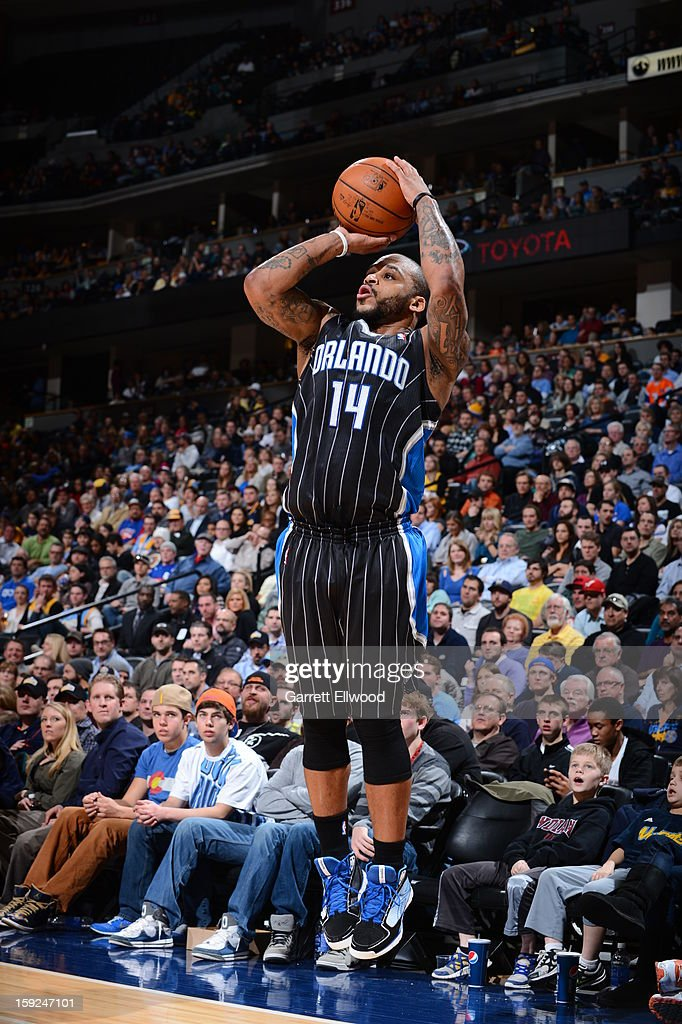 <a gi-track='captionPersonalityLinkClicked' href=/galleries/search?phrase=Jameer+Nelson&family=editorial&specificpeople=202057 ng-click='$event.stopPropagation()'>Jameer Nelson</a> #14 of the Orlando Magic shoots against the Denver Nuggets on January 9, 2013 at the Pepsi Center in Denver, Colorado.