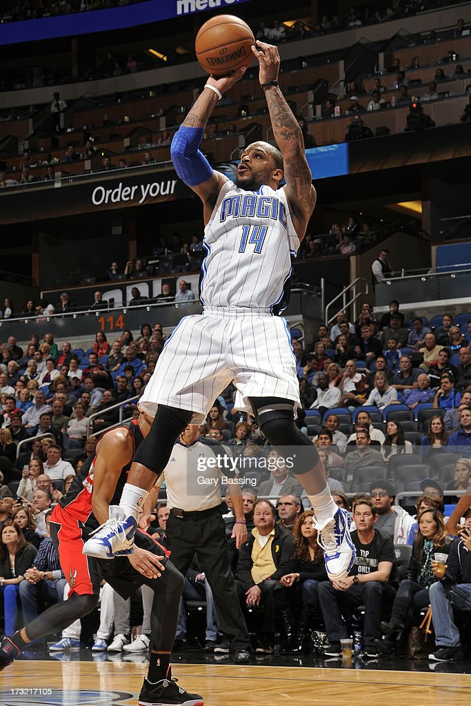 Jameer Nelson #14 of the Orlando Magic shoots during a game against the Toronto Raptors on January 24, 2013 at Amway Center in Orlando, Florida.