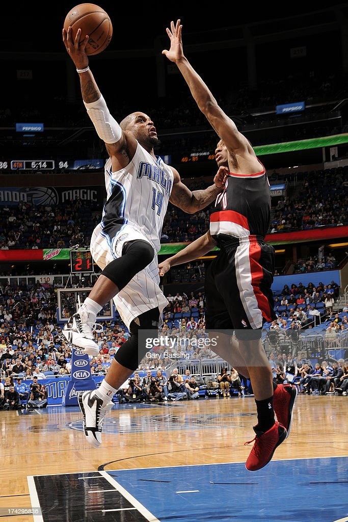 Jameer Nelson #14 of the Orlando Magic shoots the ball against Damian Lillard #0 of the Portland Trail Blazers during the game on February 10, 2013 at Amway Center in Orlando, Florida.