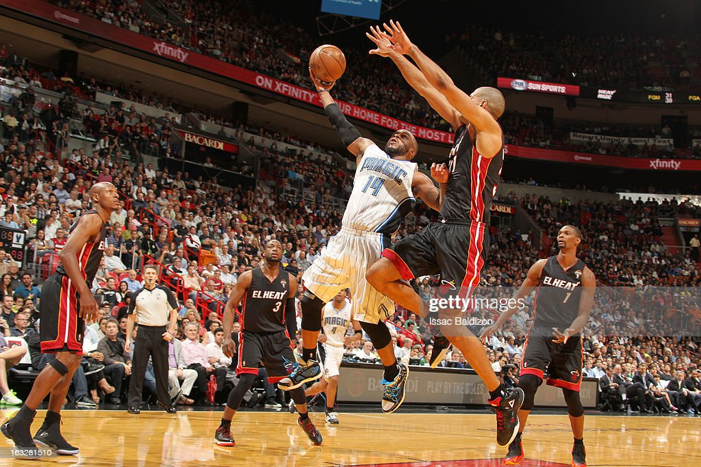 Jameer Nelson #14 of the Orlando Magic shoots under pressure during the game between the Orlando Magic and the Miami Heat on March 6, 2013 at American Airlines Arena in Miami, Florida.