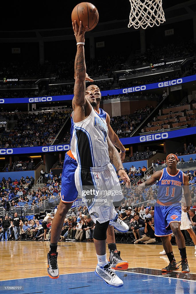 <a gi-track='captionPersonalityLinkClicked' href=/galleries/search?phrase=Jameer+Nelson&family=editorial&specificpeople=202057 ng-click='$event.stopPropagation()'>Jameer Nelson</a> #14 of the Orlando Magic shoots while defended by <a gi-track='captionPersonalityLinkClicked' href=/galleries/search?phrase=Marcus+Camby&family=editorial&specificpeople=201722 ng-click='$event.stopPropagation()'>Marcus Camby</a> #23 of the New York Knicks during the game on January 5, 2013 at Amway Center in Orlando, Florida.