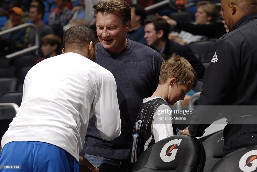 <a gi-track='captionPersonalityLinkClicked' href=/galleries/search?phrase=Jameer+Nelson&family=editorial&specificpeople=202057 ng-click='$event.stopPropagation()'>Jameer Nelson</a> #14 of the Orlando Magic signs a jersey for a young fan and his father prior to the New Orleans Hornets , Orlando Magic game on December 26, 2012 at Amway Center in Orlando, Florida.