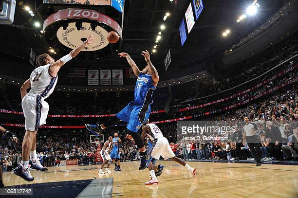 Jameer Nelson of the Orlando Magic takes the gamewinning shot against Brook Lopez of the New Jersey Nets during the game on November 13 2010 at the...