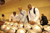 Jameer Nelson Ray Allen and LeBron James of the East AllStars autograph basketball's prior to the East AllStars practice on center court during NBA...