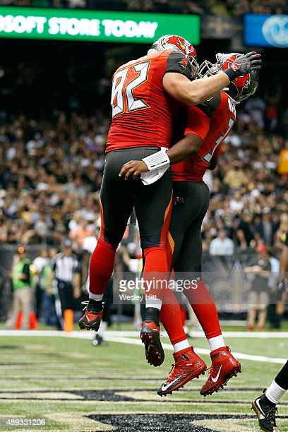 Jameis Winston celebrates his touchdown with Brandon Myers of the Tampa Bay Buccaneers during the third quarter of a game against the New Orleans...