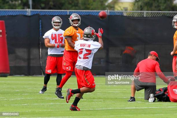 Jameis Winston makes a pass to runningback Doug Martin during the Tampa Bay Buccaneers OTA on May 23 2017 at One Buccaneer Place in Tampa Florida