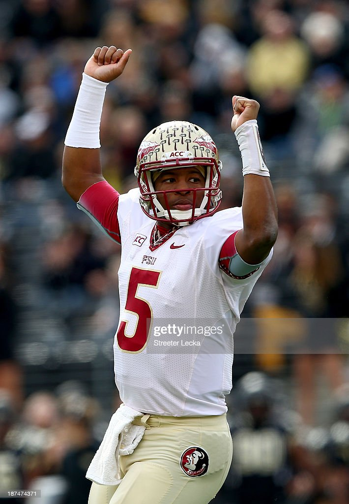 Jameis Winston of the Florida State Seminoles celebrates after a touchdown by his team during their game against the Wake Forest Demon Deacons at BBT...