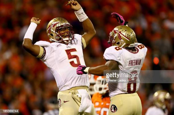 Jameis Winston of the Florida State Seminoles celebrates after throwing a touchdown with teammate Devonta Freeman of the Florida State Seminoles...
