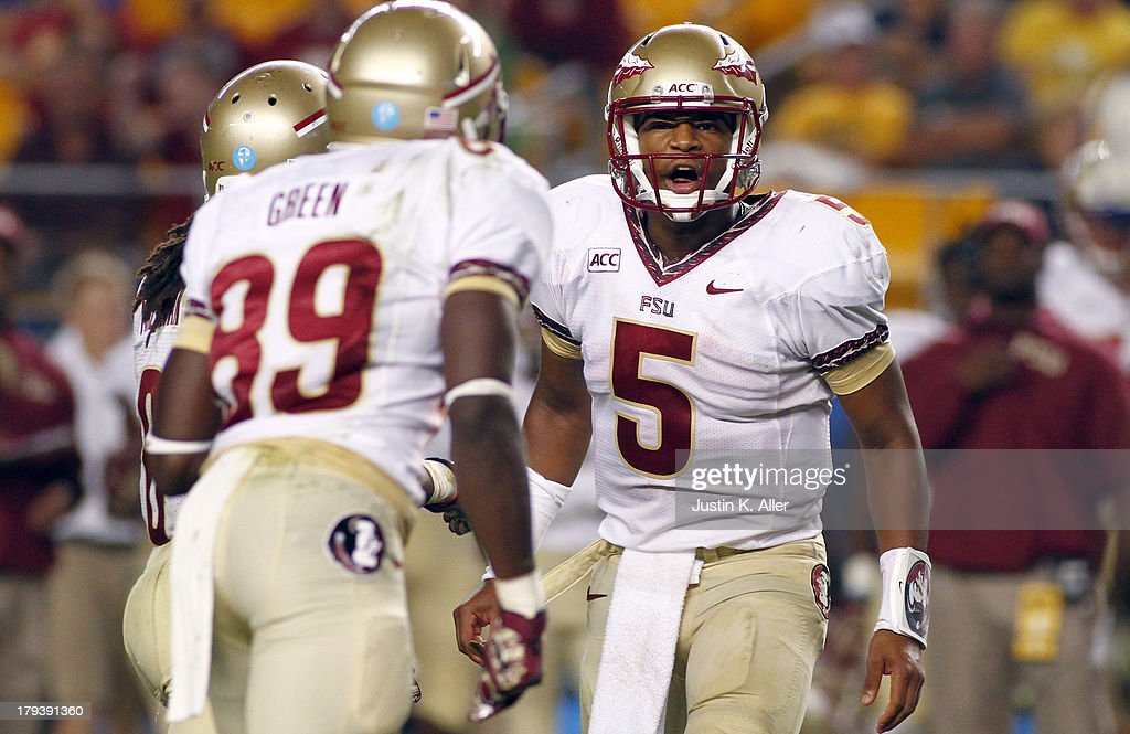 <a gi-track='captionPersonalityLinkClicked' href=/galleries/search?phrase=Jameis+Winston&family=editorial&specificpeople=8772860 ng-click='$event.stopPropagation()'>Jameis Winston</a> #5 of the Florida State Seminoles directs the offense in the second half against the Pittsburgh Panthers during the game on September 2, 2013 at Heinz Field in Pittsburgh, Pennsylvania.