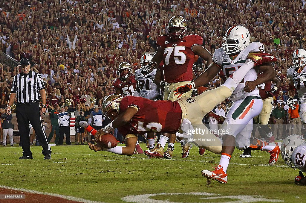 <a gi-track='captionPersonalityLinkClicked' href=/galleries/search?phrase=Jameis+Winston&family=editorial&specificpeople=8772860 ng-click='$event.stopPropagation()'>Jameis Winston</a> #5 of the Florida State Seminoles dives for the endzone during a game against the Miami Hurricanes at Doak Campbell Stadium on November 2, 2013 in Tallahassee, Florida.