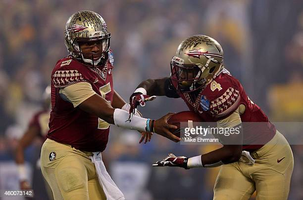 Jameis Winston of the Florida State Seminoles hands the ball off to Dalvin Cook for a 1st quarter rush against the Georgia Tech Yellow Jackets during...