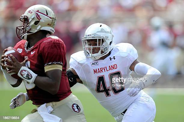 Jameis Winston of the Florida State Seminoles is tackled by Matt Robinson of the Maryland Terrapins at Doak Campbell Stadium on October 5 2013 in...