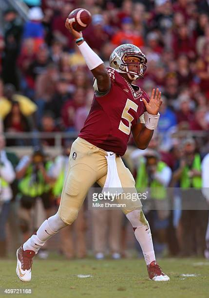 Jameis Winston of the Florida State Seminoles looks turnover pass during a game against the Florida Gators at Doak Campbell Stadium on November 29...