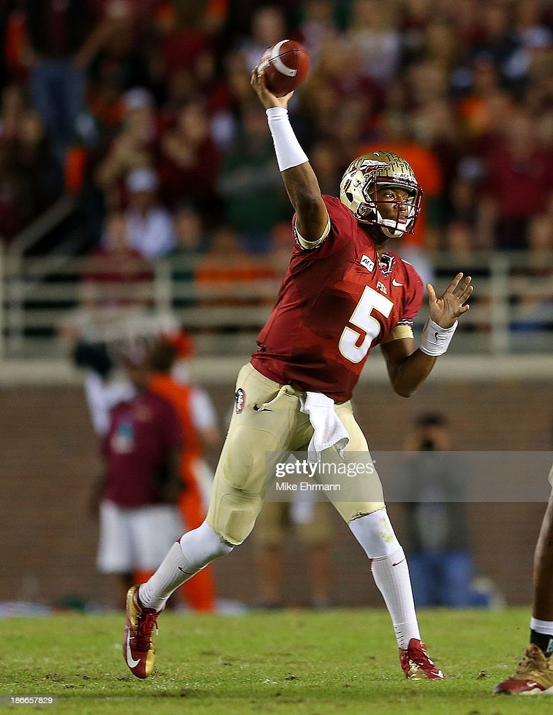 <a gi-track='captionPersonalityLinkClicked' href=/galleries/search?phrase=Jameis+Winston&family=editorial&specificpeople=8772860 ng-click='$event.stopPropagation()'>Jameis Winston</a> #5 of the Florida State Seminoles passes during a game against the Miami Hurricanes at Doak Campbell Stadium on November 2, 2013 in Tallahassee, Florida.